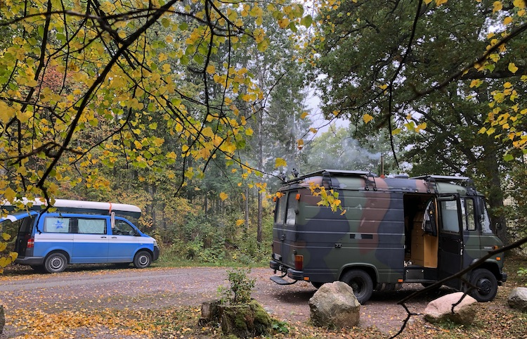 Vans parked near lake Vällen