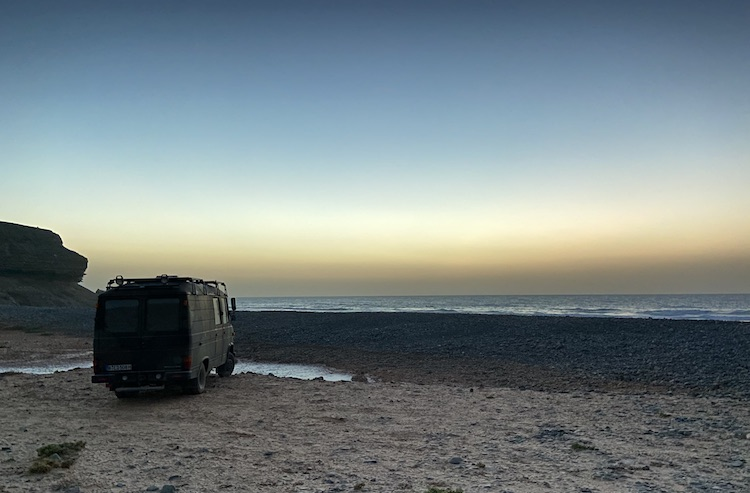 Van parked in front of Playa de Vigocho