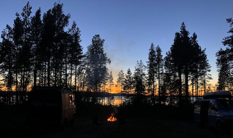 Twilight and a campfire at lake Storsjön
