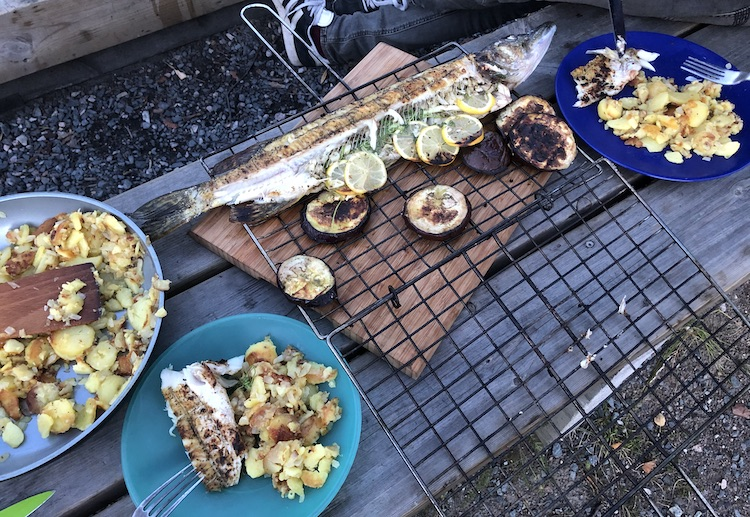Pike prepared with garlic, lemon, herbs, olive oil and roast potatoes