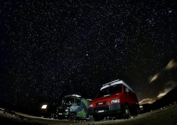 Vans parked under the stars